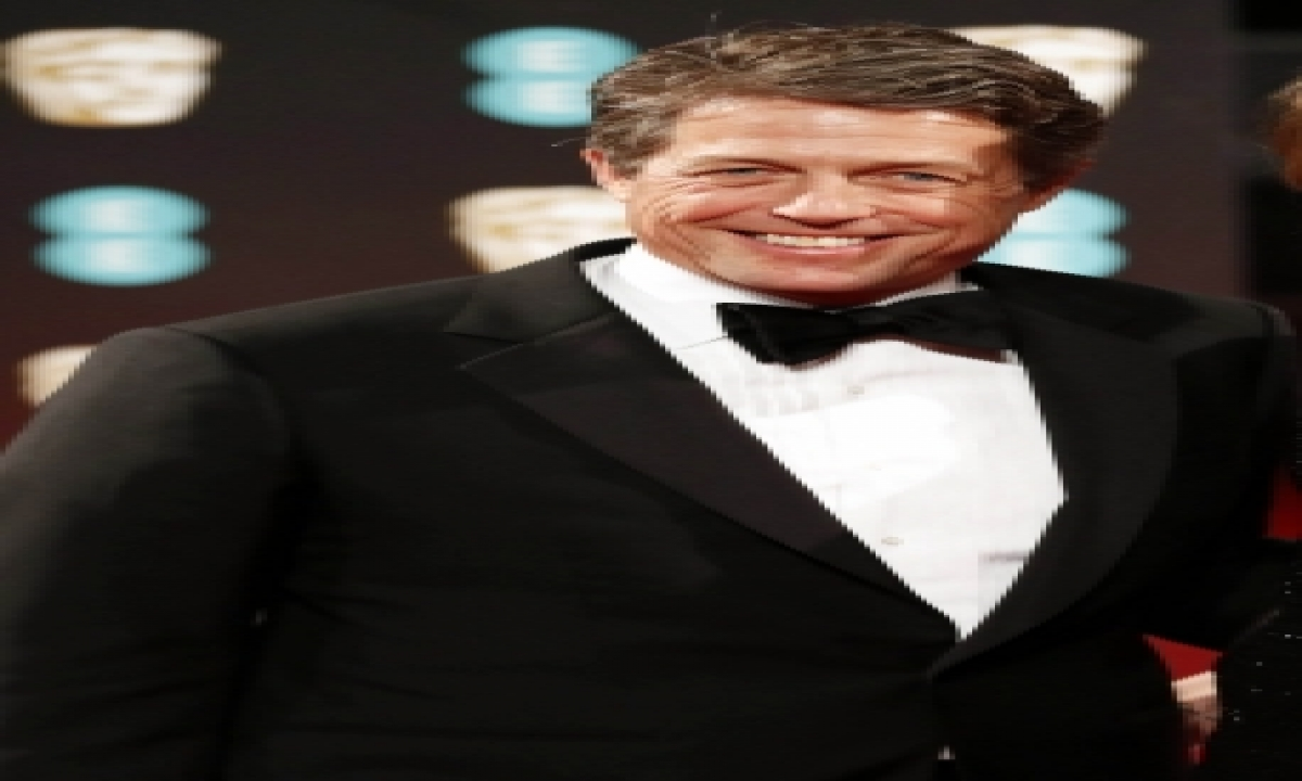 TeluguStop.com - Hugh Grant 'trying To Be A Young Father In An Old Man's Body' At 60