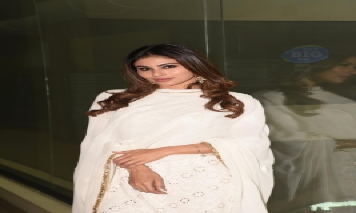 TeluguStop.com - Mouni Roy Flaunts Perfect Curves In Striped Bikini