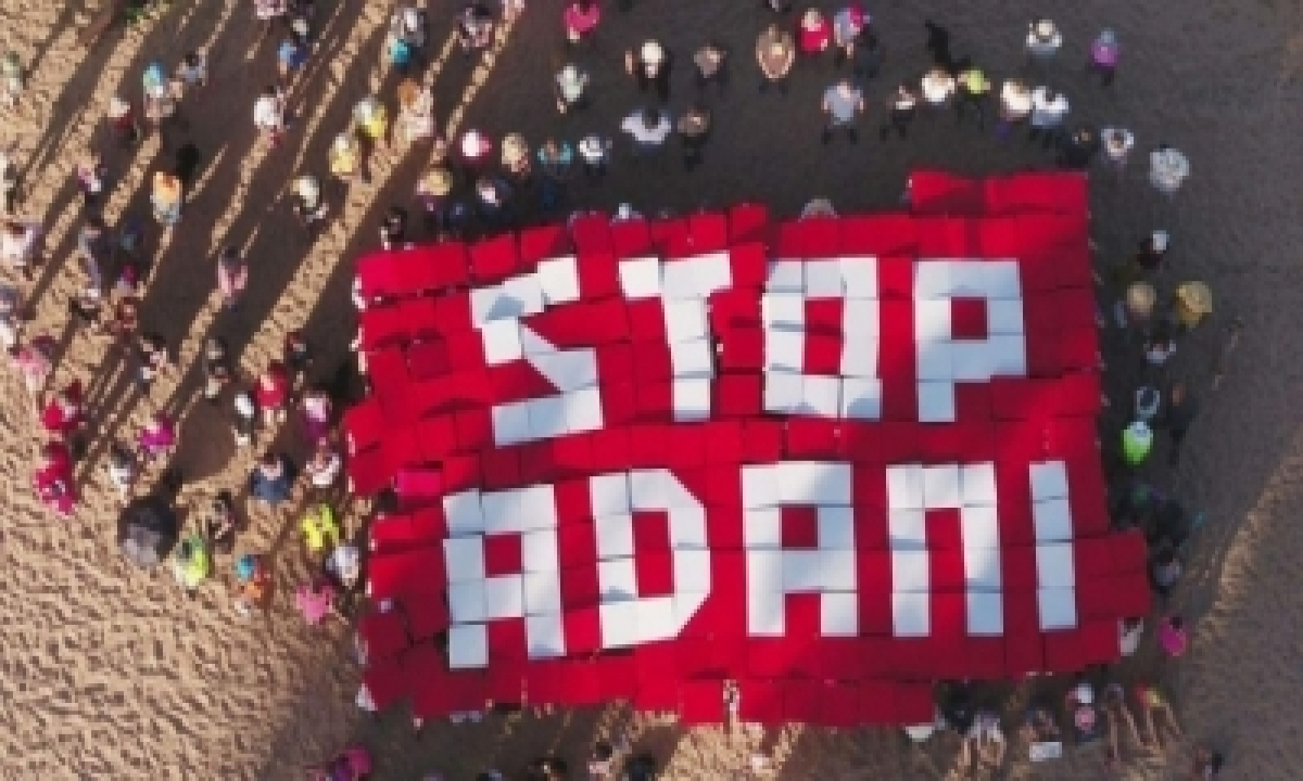 TeluguStop.com - Private Investigator Hired By Adani Photographed Aussie Activist's Daughter On Way To School: Report