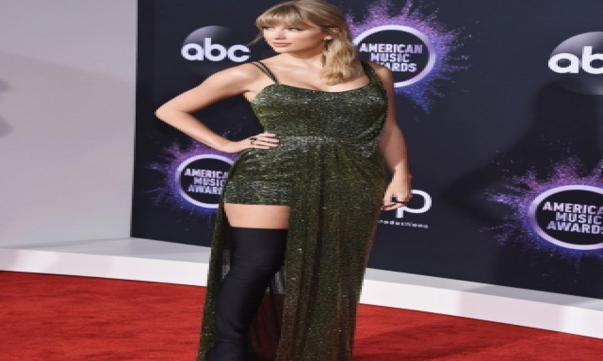 TeluguStop.com - Taylor Swift Wins Artist Of The Year At Amas 2020, Reveals Why She Missed Gala