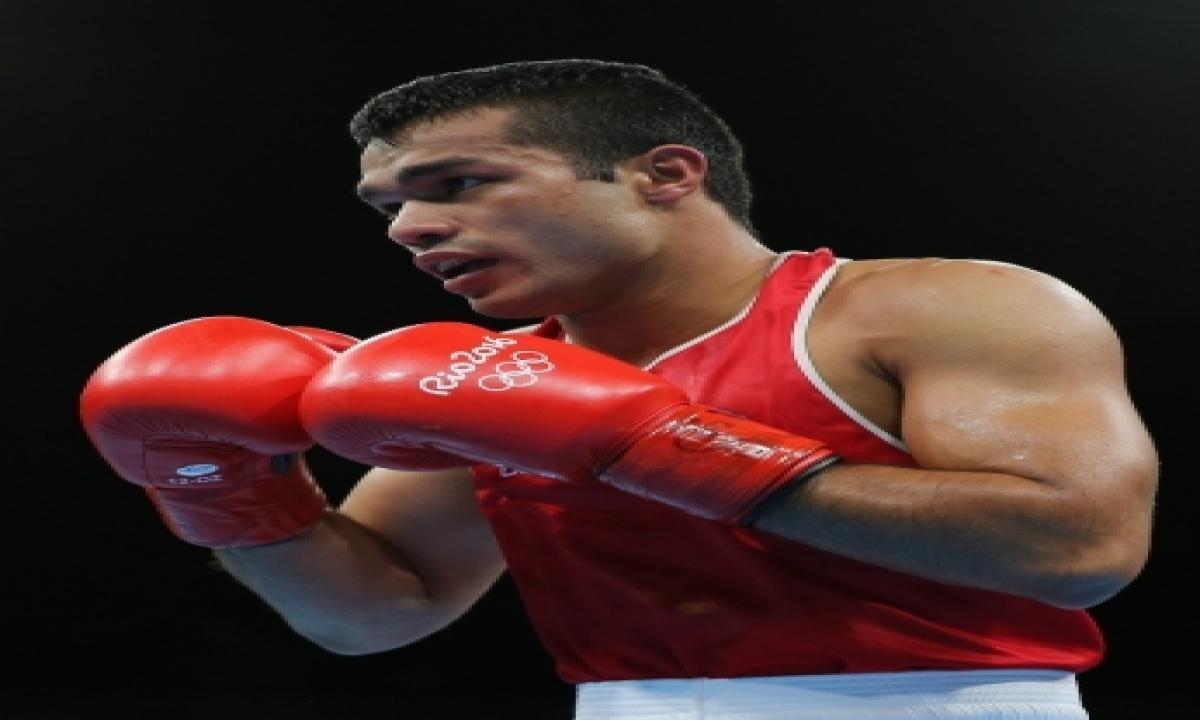 TeluguStop.com - Vikas Krishan's Coach Stuck In Us, Boxers Seeks Mea's Help