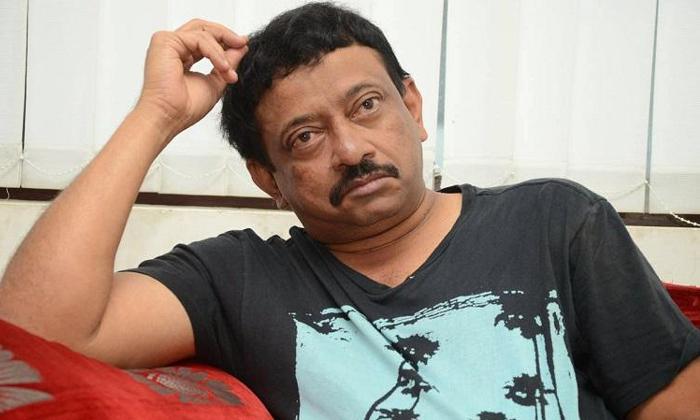Rgv Press Meet On Road In Vijayawada