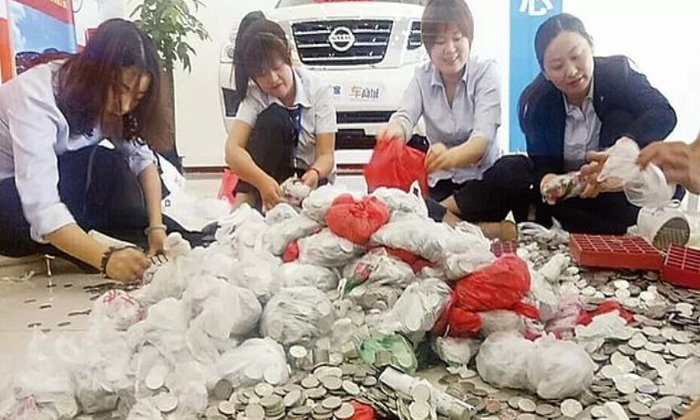 China Woman Buys Car With 66 Bags Of Coins