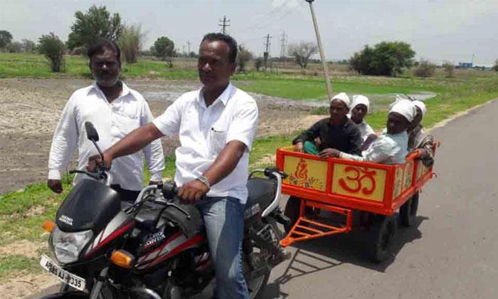 Farmer Invents Bike Trolley For Transportation