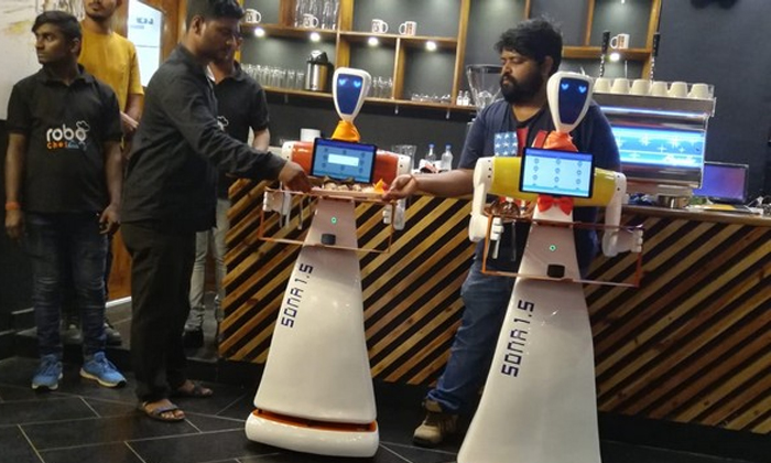 Odisha Made In India Robots To Serve Food At This Bhubaneswar Restaurant-present Genaration Human Depend On The Robots,robots Helps In Human And They Are Work With Human,robots Serve For Customers Tel-Odisha Made In India Robots To Serve Food At This Bhubaneswar Restaurant-Present Genaration Human Depend On The Robots Helps And They Are Work With For Customers