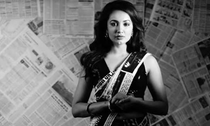 Pic Talk: Big Boss Girl Wrapped In A Newspaper Saree-Movie-English-Telugu Tollywood Photo Image