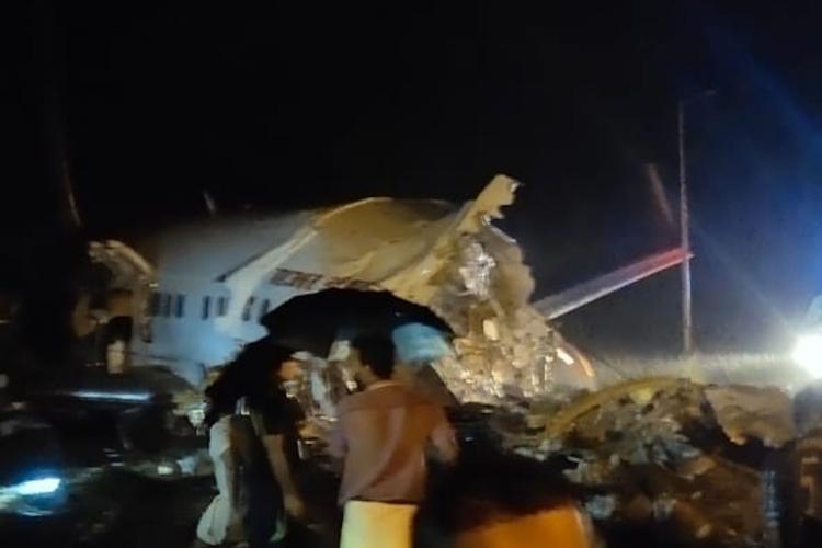 TeluguStop.com - Air India Plane Skids Off Runway In Kozhikodi, Kerala.