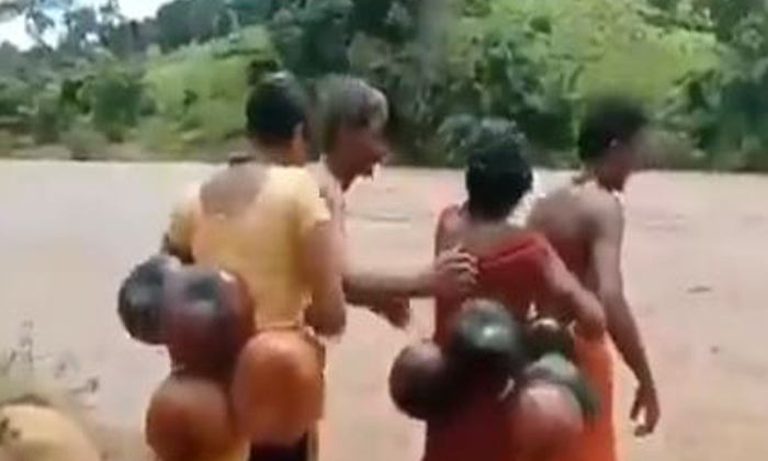 TeluguStop.com - Viral Video: Anganwadi Workers Treks And Swims To Attend The Duties In Odisha.
