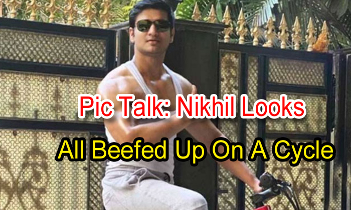 TeluguStop.com - Pic Talk: Nikhil Looks All Beefed Up On A Cycle