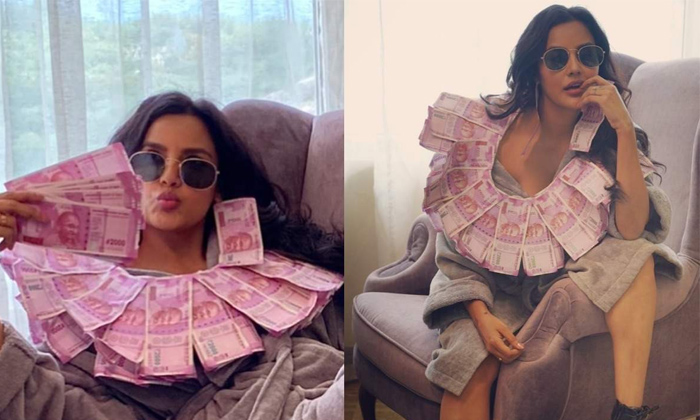 TeluguStop.com - Priya Anand Photos With Money Goes Viral!