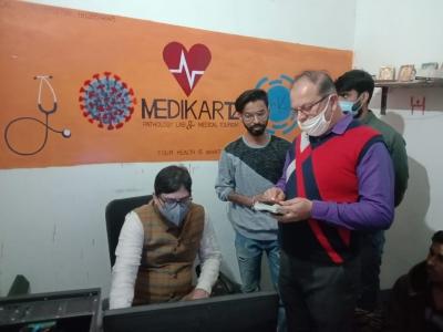 TeluguStop.com - Two Held For Giving False Covid Test Reports In Gurugram-Crime News English-Telugu Tollywood Photo Image