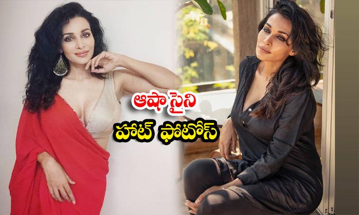 Bollywood actress flora saini romantic poses-ఆషా సైని హాట్ ఫొటోస్